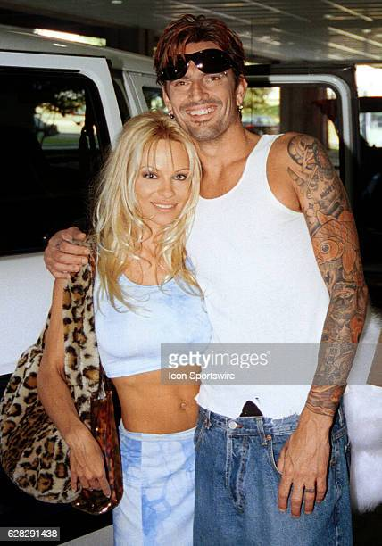 Pamela Anderson of BAYWATCH fame and Tommy Lee of Motley Crue fame as they leave Tampa International Airport in Tampa Florida
