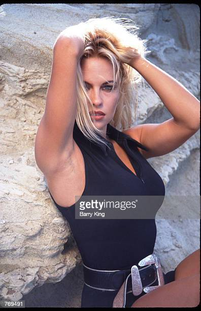 Pamela Anderson poses August 25 1992 on Malibu Beach CA Anderson is a model and actress playing a role in the tv show Baywatch