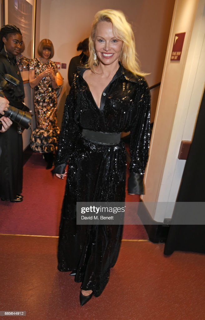Pamela Anderson poses backstage at The Fashion Awards 2017 in partnership with Swarovski at Royal Albert Hall on December 4, 2017 in London, England.
