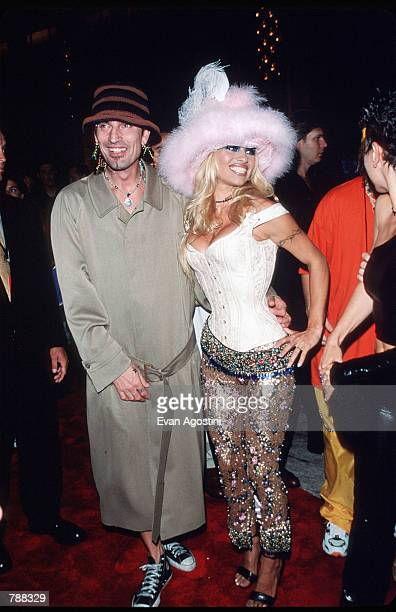 Pamela Anderson poses for a picture with husband Tommy Lee on September 9 1999 at the MTV Video Music Awards in New York City Anderson got her start...