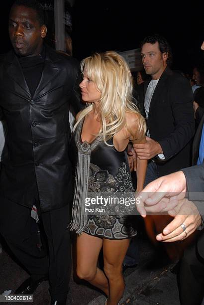 Pamela Anderson Security and A Guest during 2007 Cannes Film Festival Pamela Anderson Party at VIP Room Palm Beach in Cannes France