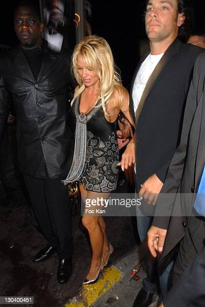 Pamela Anderson Security and Guest during 2007 Cannes Film Festival Pamela Anderson Party at VIP Room Palm Beach in Cannes France