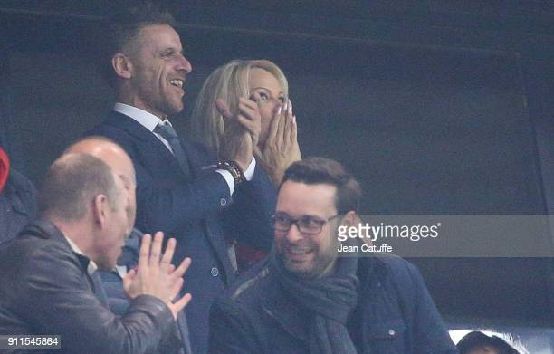Pamela Anderson sends a kiss to boyfriend Adil Rami of OM after he scores a goal after 7 minutes into the match during the French Ligue 1 match...