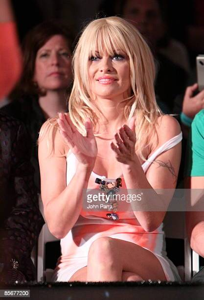 Pamela Anderson sits front row at Richie Rich runway show at Fontainebleau Miami Beach on March 27 2009 in Miami Beach Florida