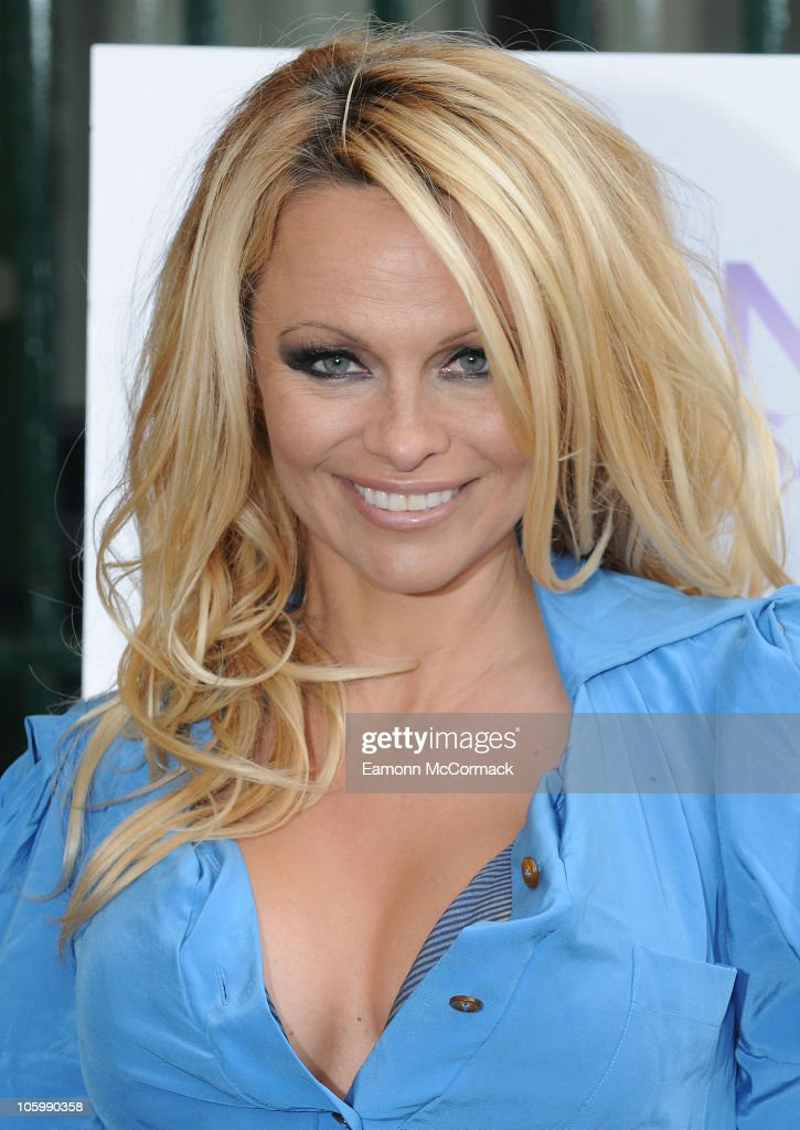 Pamela Anderson unveils her new PETA ad, which features