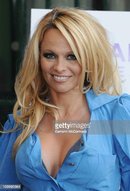 Pamela Anderson unveils her new PETA ad which features her nearly naked body covered in paint markings at Covent Garden on October 24 2010 in London...