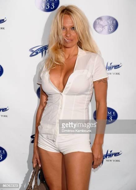 Pamela Anderson walks the red carpet at the official grand opening of Sapphire New York Gentlemen's Club Prime 333 Steakhouse at Sapphire New York on...
