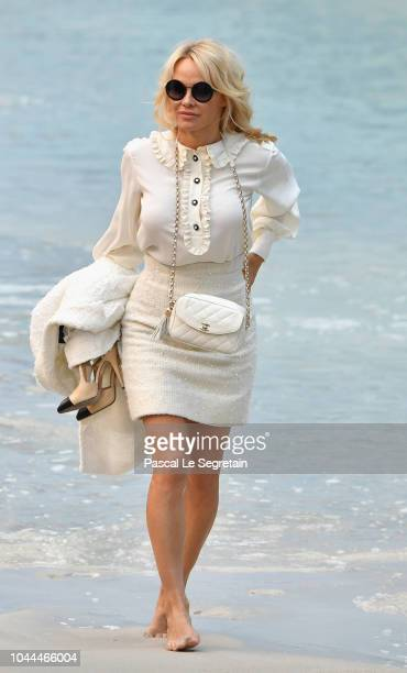 Pamela Anderson walks the runway after the Chanel show as part of the Paris Fashion Week Womenswear Spring/Summer 2019 on October 2 2018 in Paris...