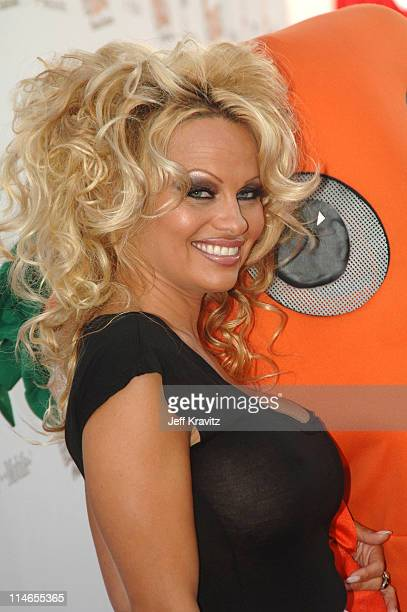 Pamela Anderson with Chris P Carrot PETA mascot during Comedy Central Roast of Pamela Anderson Red Carpet at Sony Studio in Culver City California...