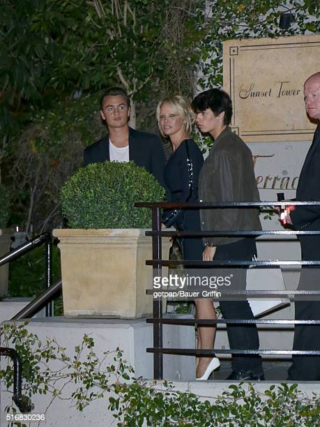 Pamela Anderson with her sons Brandon Thomas Lee and Dylan Jagger Lee are seen leaving 'Fashion Los Angeles Awards' at Sunset Tower Hotel on March 20...
