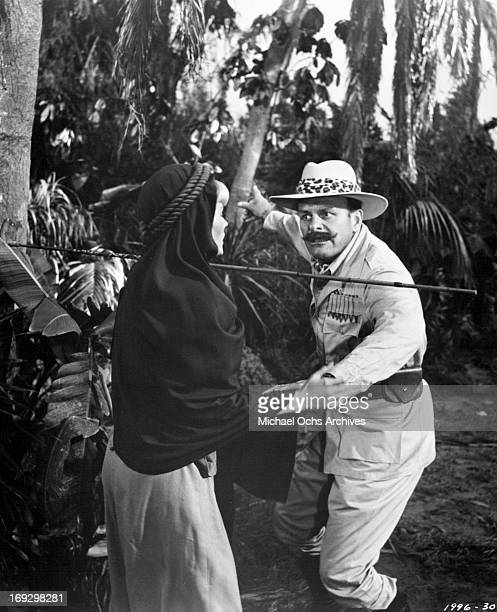 Pamela Austin is rescued by Terry Thomas in a scene from the film 'The Perils Of Pauline' 1967 Photo by Universal/Getty Images