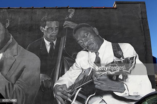 Pamela Bliss' 'Jazz Masters of Indiana Avenue' mural featuring Larry Ridley and Wes Montgomery on the side of Musicians' Repair Sales on December 22...