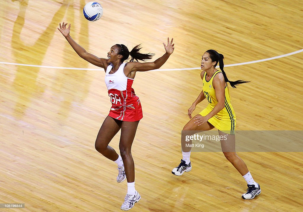 Pamela Cookey of England and Mo'onia Gerrard of Australia compete for the ball during the Women Semifinals Match between Australia and England at the Thyagaraj Sports Complex during day nine of the 2010 Commonwealth Games on October 12, 2010 in Delhi, India.