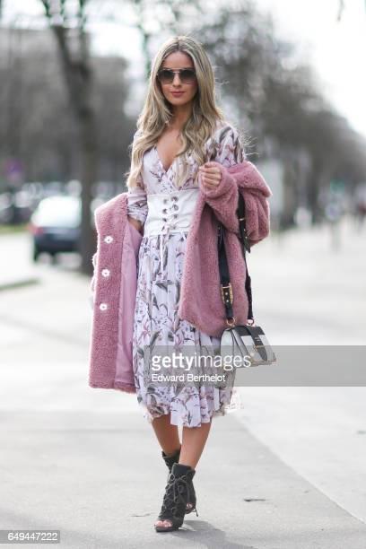 Pamela Cortes wears a pink fur coat a flower print dress a Prada bag outside the Miu Miu show during Paris Fashion Week Womenswear Fall/Winter...