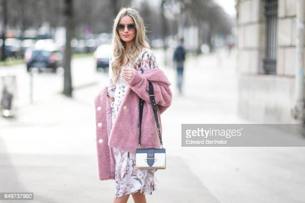 Pamela Cortes wears a pink fur coat a flower print dress a Prada bag outside the Miu Miu show during Paris Fashion Week Womenswear Fall/Winter...
