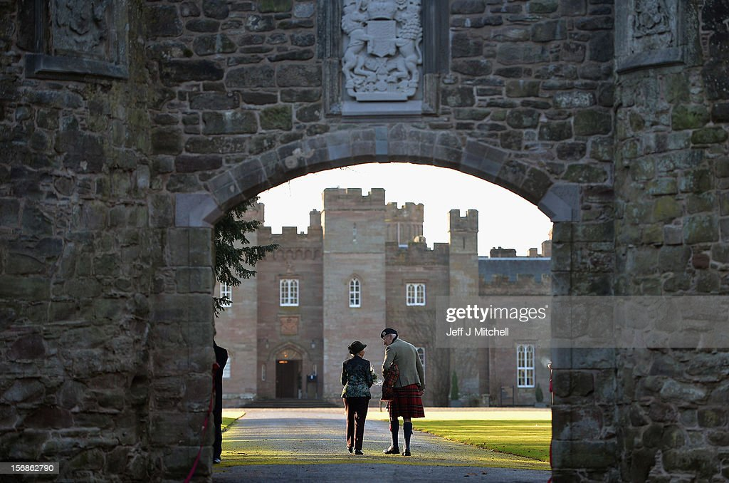 Pamela Countess of Mansfield and piper Malcolm Innes from Kilspindie help unveil the restored historic archway at Scone Palace on November 23, 2012 in Perth,Scotland. The iconic 16th century arch, which was all that remained of the approach to the Augustinian Abbey which once stood on the Palace lawns, was destroyed after a contractor driving a van crashed into it two years ago. Scone Palace is best known as the place where former kings of Scotland were crowned and the original home of the Stone of Destiny.