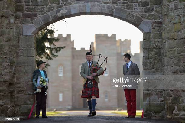 Pamela Countess of Mansfield William Murray Master of Stormont and piper Malcolm Innes from Kilspindie help unveil the restored historic archway at...