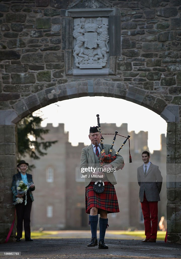 Pamela Countess of Mansfield , William Murray Master of Stormont and piper Malcolm Innes from Kilspindie help unveil the restored historic archway at Scone Palace on November 23, 2012 in Perth,Scotland. The iconic 16th century arch, which was all that remained of the approach to the Augustinian Abbey which once stood on the Palace lawns, was destroyed after a contractor driving a van crashed into it two years ago. Scone Palace is best known as the place where former kings of Scotland were crowned and the original home of the Stone of Destiny.