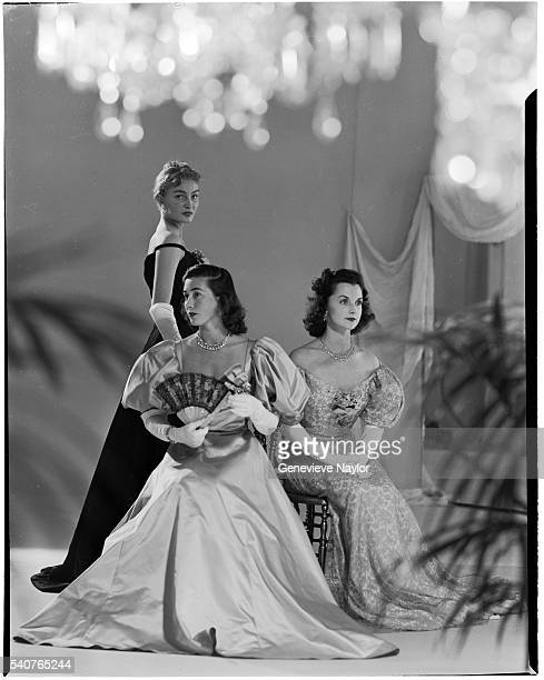 Pamela Curran Jeanne Murray and Mrs Vanderbilt model evening wear for the fiftieth anniversary of the Gibson Ball in 1948