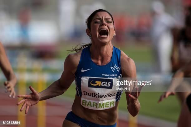 Pamela Dutkiewicz celebrates after winning women's 110 Meter Hurdle Final at day 1 of the German Championships in Athletics at Steigerwaldstadion on...