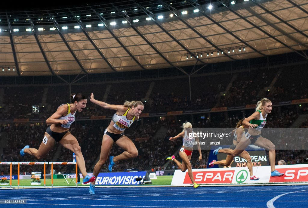 Pamela Dutkiewicz of Germany, Cindy Roleder of Germany and Elvira Herman of Belarus cross the finish line in the Women's 100m Hurdles Final during day three of the 24th European Athletics Championships at Olympiastadion on August 9, 2018 in Berlin, Germany. This event forms part of the first multi-sport European Championships.