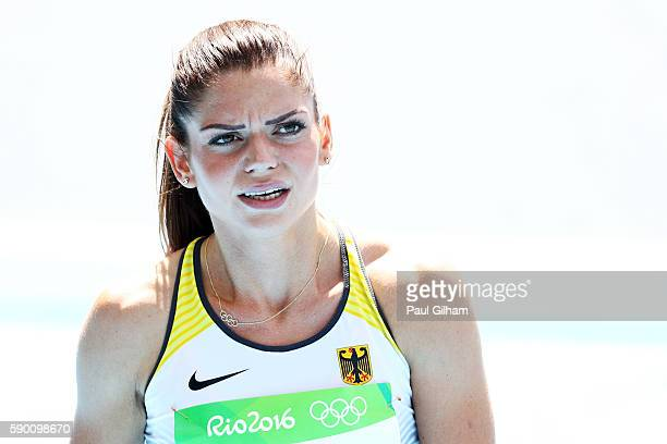 Pamela Dutkiewicz of Germany reacts after the Women's 100m Hurdles Round 1 Heat 5 on Day 11 of the Rio 2016 Olympic Games at the Olympic Stadium on...