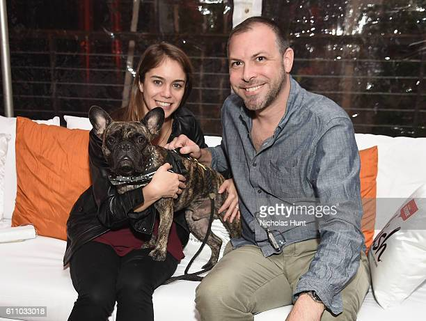 Pamela Garber and Chad Garber pose with Jaques during the celebration of the launch of Rachael Ray's Nutrish DISH with a Puppy Party on September 28,...