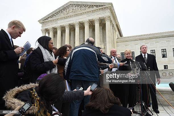 Pamela Hurst, right center, stands near her husband, Douglas Hurst as she talks to the media outside the Supreme Court of the United States as the...