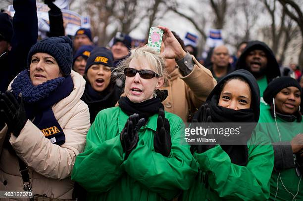 Pamela Jenkins center and Krystal Cooper right from the American Federation of State County and Municipal Employees attend a rally with labor groups...