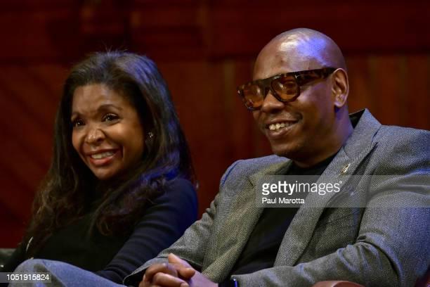 Pamela Joyner and Dave Chappelle on stage at the WEB Du Bois Medal Award Ceremony at Harvard University on October 11 2018 in Cambridge Massachusetts...