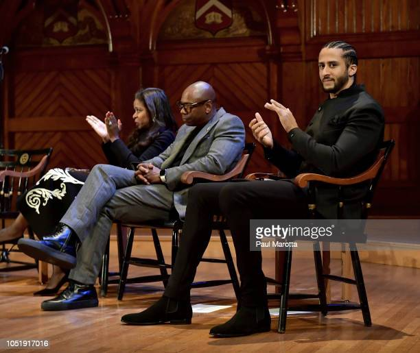 Pamela Joyner Dave Chappelle and Colin Kaepernick on stage at the WEB Du Bois Medal Award Ceremony at Harvard University on October 11 2018 in...