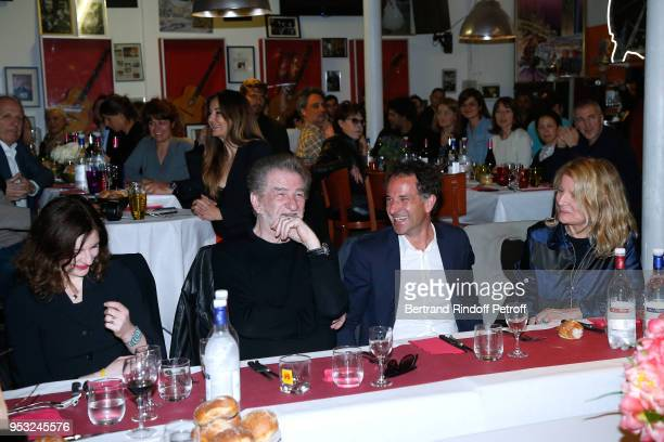 Pamela Mitchell her father Eddy Mitchell Xavier Lardoux and Nicole Garcia attend the Dinner in honor of Nathalie Baye at La Chope des Puces on April...