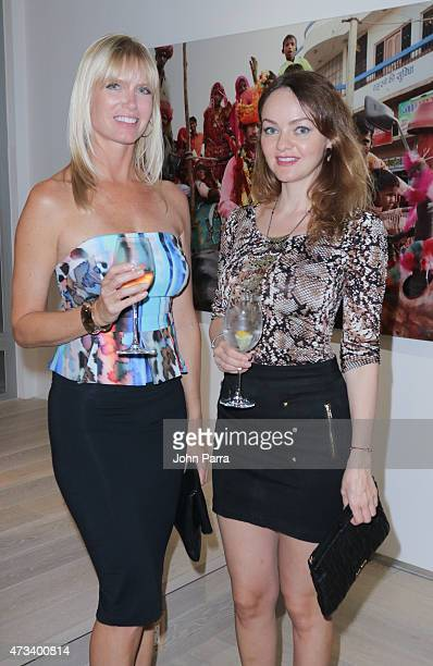 Pamela Moore and Simona Paige attend the Robert Curran Gallery on May 14 2015 in Miami Florida