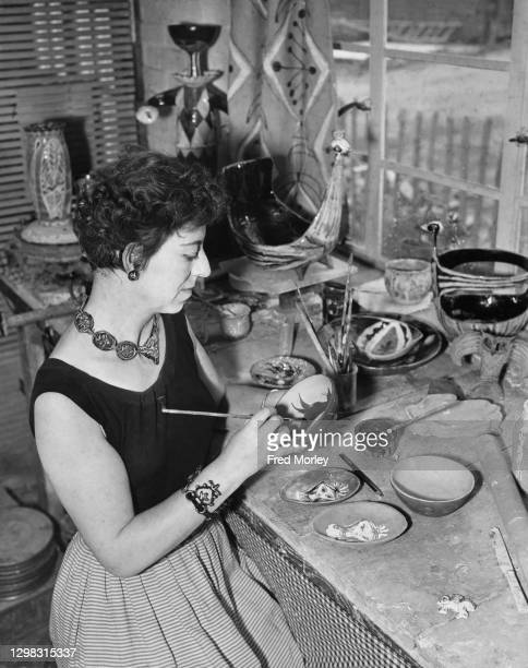 Pamela Nash painting a design in oxide on a clay-thrown bowl in the pottery studio run by Nash and her husband, Ernest Collyer, the Orchard Pottery...