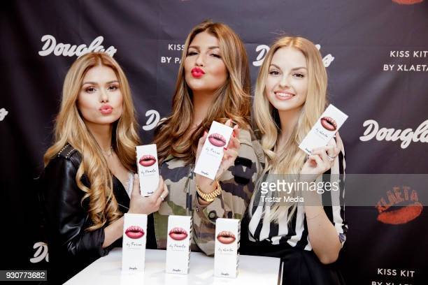 Pamela Reif Farina Opoku and Julia Maria pose during the Influencer at Douglas KissKits event on March 12 2018 in Hamburg Germany