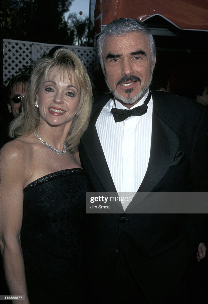 Pamela Seals and Burt Reynolds during The 70th Annual Academy Awards - Red Carpet at Shrine Auditorium in Los Angeles, California, United States.