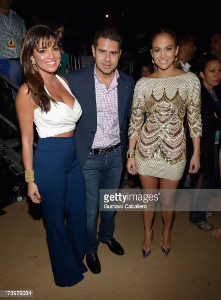 Pamela Silva Conde Cesar Conde and Jennifer Lopez pose backstage during the Premios Juventud 2013 at Bank United Center on July 18 2013 in Miami...