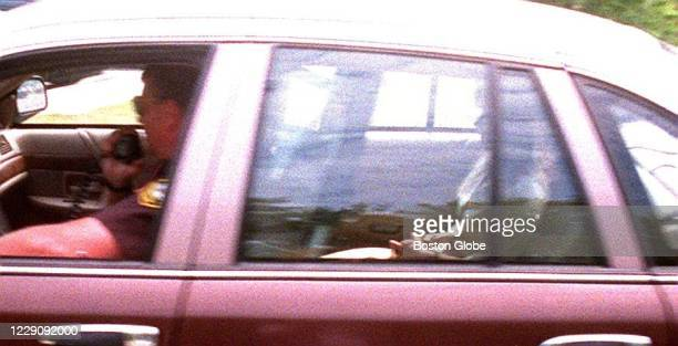 Pamela Smart in the back of the police car is rushed from court back to jail after her appearance at the Rockingham County Courthouse in Brentwood,...