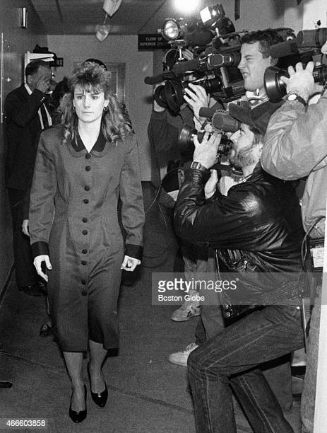 Pamela Smart walks past television cameras inside the Rockingham County Superior Court in Exeter, N.H., on March 21 during the second day of jury...