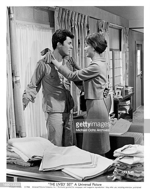 Pamela Tiffin affectionately shows James Darren she is happy to see him again in a scene from the film 'The Lively Set', 1964.