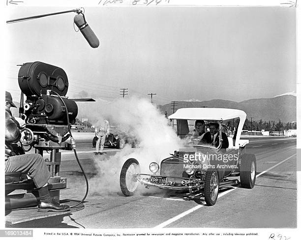 Pamela Tiffin and Doug McClure being filmed for a scene in a moving custom hotrod from the film 'The Lively Set', 1964.