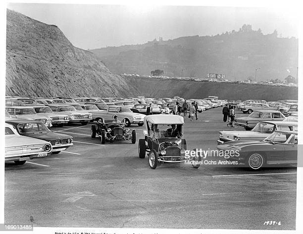 Pamela Tiffin and Doug McClure leaves the parking lot in their custom hotrod in a scene from the film 'The Lively Set', 1964.