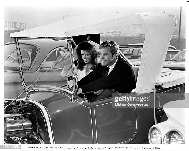 Pamela Tiffin and Doug McClure wait impatiently to race his custom hotrod in a scene from the film 'The Lively Set', 1964.