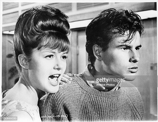 Pamela Tiffin and Horst Buchholz reacting in a scene from the film 'One Two Three' 1961