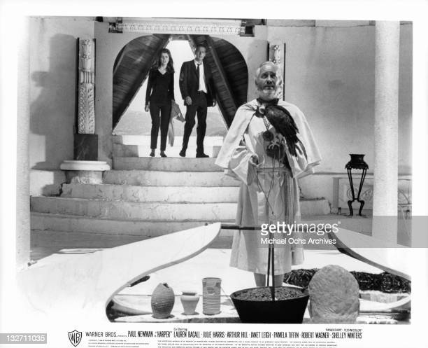 Pamela Tiffin and Paul Newman invade a temple in a scene from the film 'Harper' 1966