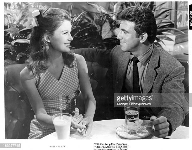 Pamela Tiffin has a drink with Anthony Franciosa in a scene from the film 'The Pleasure Seekers', 1964.