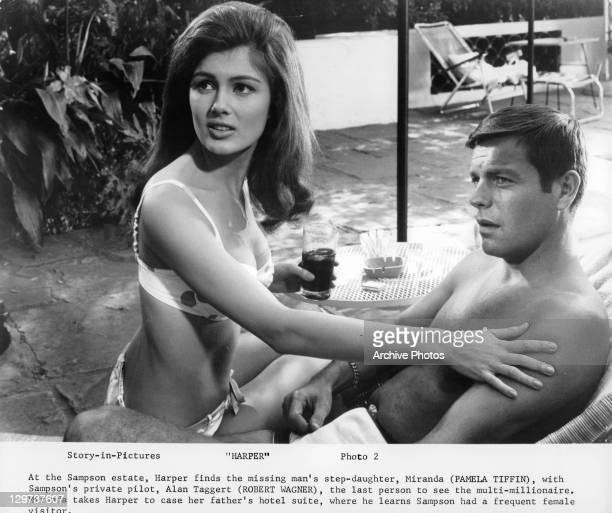 Pamela Tiffin in a bikini sitting next to Robert Wagner in a scene from the film 'Harper' 1966