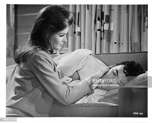 Pamela Tiffin lovingly touches James Darren on his cheek while he is sleeping in a scene from the film 'The Lively Set', 1964.
