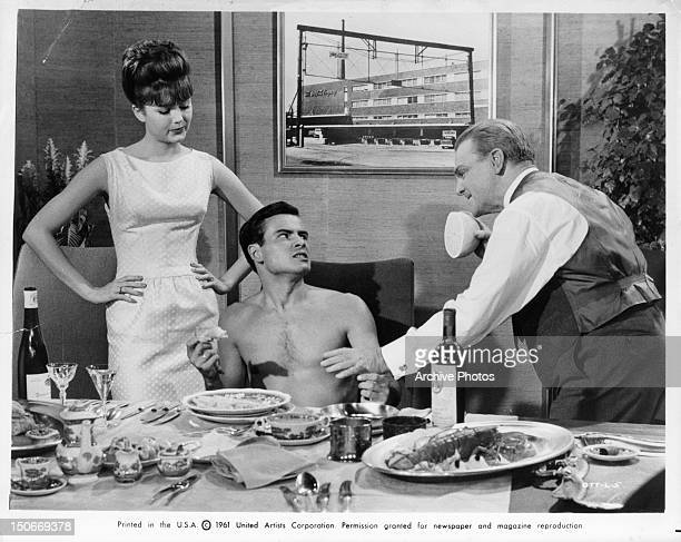 Pamela Tiffin watching as Horst Buchholz and James Cagney are about to get into a food fight in a scene from the film 'One Two Three' 1961