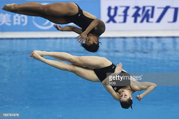 Pamela Ware and Jennifer Abel of Canada compete in the Women's 3m Springboard Synchro Final during day one of the FINA Diving World Series Beijing...